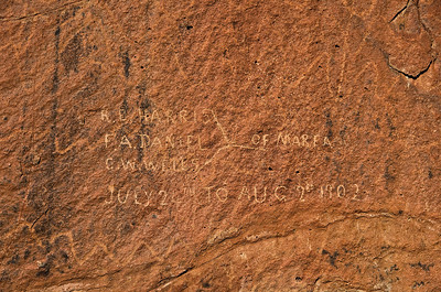 Petroglyphs with turn-of-the-century graphitti at Indian Head.