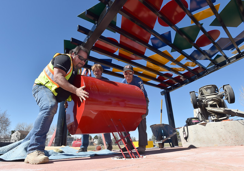 "John Medina, left,  and Geraldo  Hernandez, right,  of Creative Construction with with blacksmith David Norrie, center, install a cylindrical geometric shape into the Geometry Park in Mike Romero Park in Lafayette on Thursday.<br /> More photos:  <a href=""http://www.dailycamera.com"">http://www.dailycamera.com</a><br /> David R. Jennings/Staff Photographer<br /> March 10, 2016"