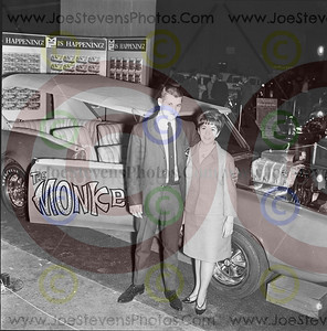 The Monkee Mobile was a popular car on this night in 1967 as several couples wanted their photo taken beside it at the Montreal, Quebec Autorama.  Can you blame them?  the Monkee were the biggest hit group out since the Beatles.