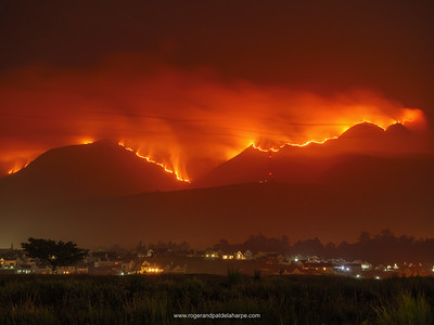 The fire on the Outeniqua Mountains with the city of George in the foreground. Garden Route. Western Cape. South Africa