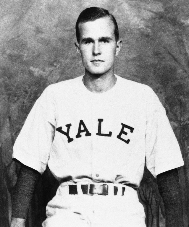 . FILE - In this 1947 photo, George H.W. Bush is shown as captain of the Yale baseball team, in New Haven, Conn. Bush played in the first-ever College World Series in 1947. (Bush died Nov. 30, 2018, at the age of 94. Bush was largely known for his work in public office, from his time as a Texas congressman and CIA director to his years in the White House as president and Ronald Reagan\'s vice president. But the World War II hero and great-grandfather also was an avid skydiver, played in the first-ever College World Series and was the longest-married president in U.S. history.AP Photo/File)