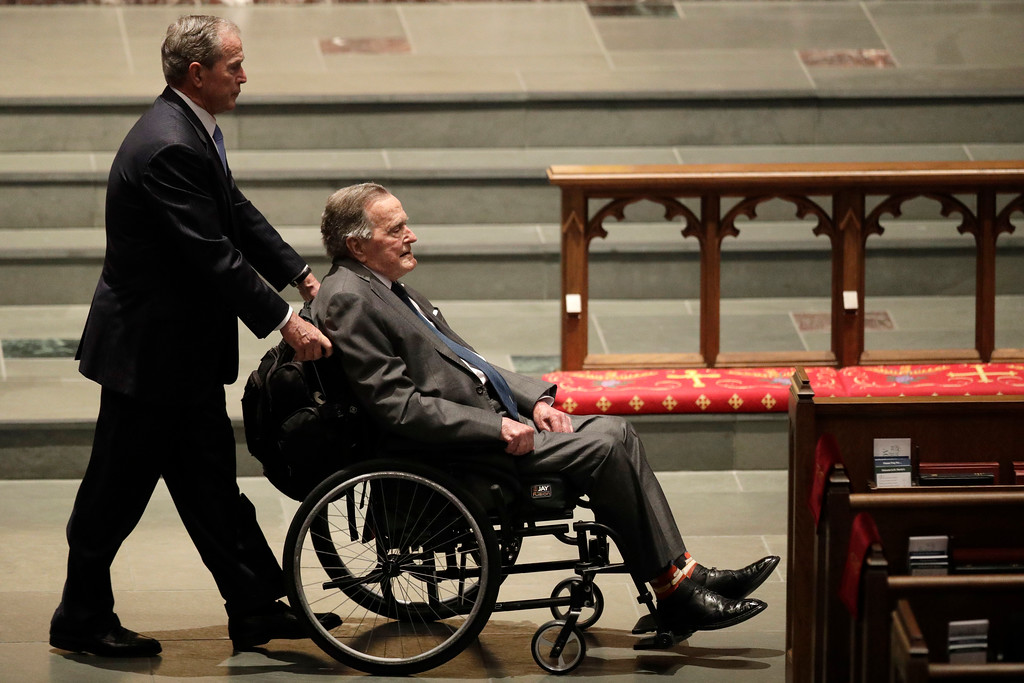 . FILE - In this April 21, 2018 file photo, former Presidents George W. Bush, left, and George H.W. Bush arrive at St. Martin\'s Episcopal Church for a funeral service for former first lady Barbara Bush,  in Houston. Bush has died at age 94. Family spokesman Jim McGrath says Bush died shortly after 10 p.m. Friday, Nov. 30, 2018, about eight months after the death of his wife, Barbara Bush. (AP Photo/David J. Phillip, File)