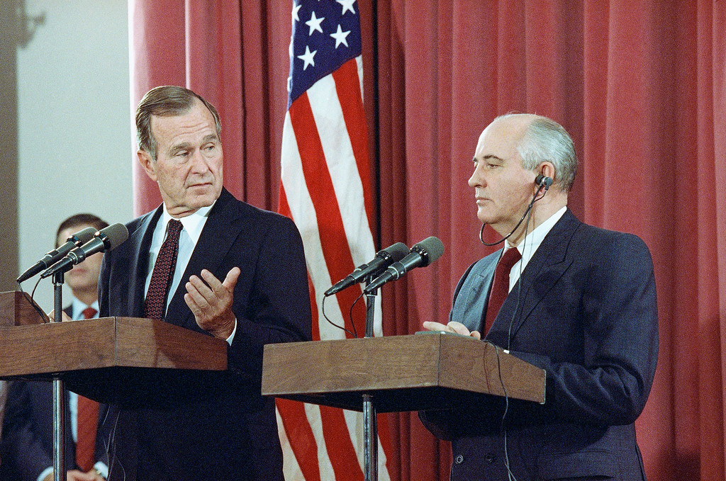 . FILE - In this Oct. 29, 1991, file photo, President George H.W. Bush gestures during a joint news conference with Soviet President Mikhail Gorbachev,  at the Soviet Embassy in Madrid. Bush died at the age of 94 on Friday, Nov. 30, 2018, about eight months after the death of his wife, Barbara Bush. (AP Photo/Jerome Delay, File)