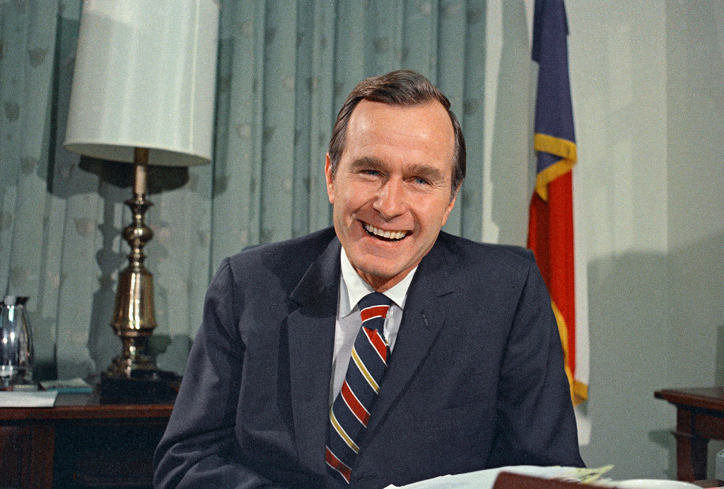 . FILE - In this Dec. 18, 1970, file photo, newly appointed United Nations Ambassador George H. Bush smiles. Bush has died at age 94. Family spokesman Jim McGrath says Bush died shortly after 10 p.m. Friday, Nov. 30, 2018, about eight months after the death of his wife, Barbara Bush. (AP Photo/John Duricka, File)