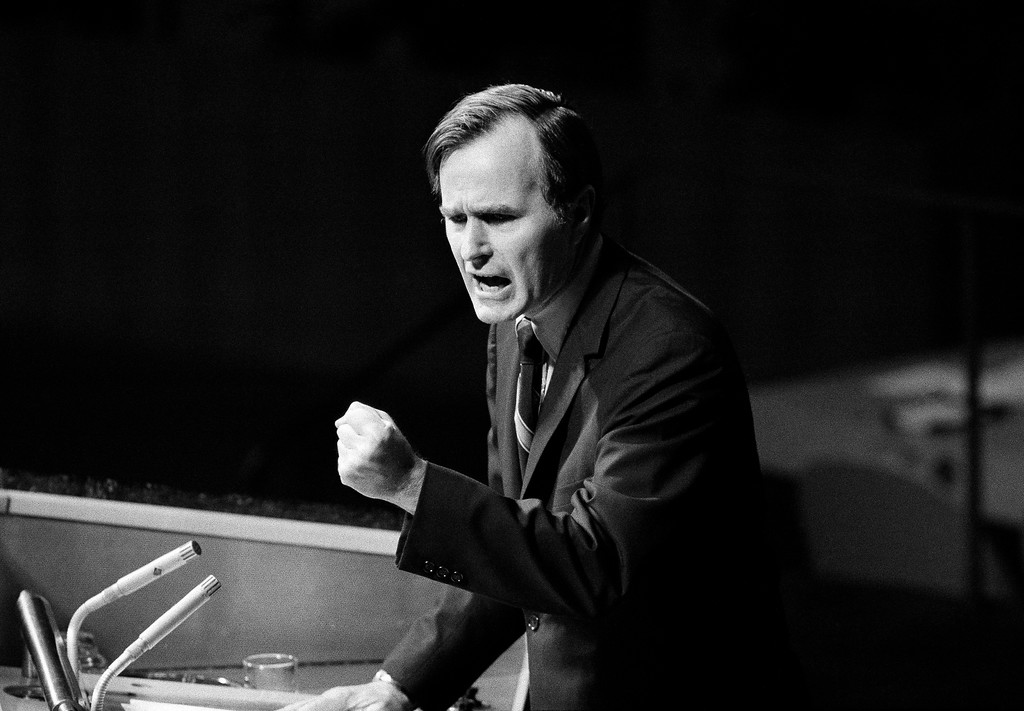". FILE - In this Oct. 18, 1971, file photo, U.S. Ambassador George H.W. Bush gestures as he addresses the United Nations General Assembly during the China debate. He denied the U.S. formula was either a ""Two Chinas\"" or a \""One China and one Taiwan\"" plan. Bush died at the age of 94 on Friday, Nov. 30, 2018, about eight months after the death of his wife, Barbara Bush. (AP Photo/File)"