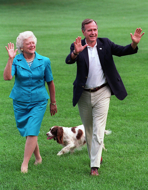 . FILE - In this Aug. 24, 1992, file photo, President George H.W. Bush and first lady Barbara Bush walk with their dog Millie across the South Lawn as they return to the White House. Bush has died at age 94. Family spokesman Jim McGrath says Bush died shortly after 10 p.m. Friday, Nov. 30, 2018, about eight months after the death of his wife, Barbara Bush. (AP Photo/Scott Applewhite, File)