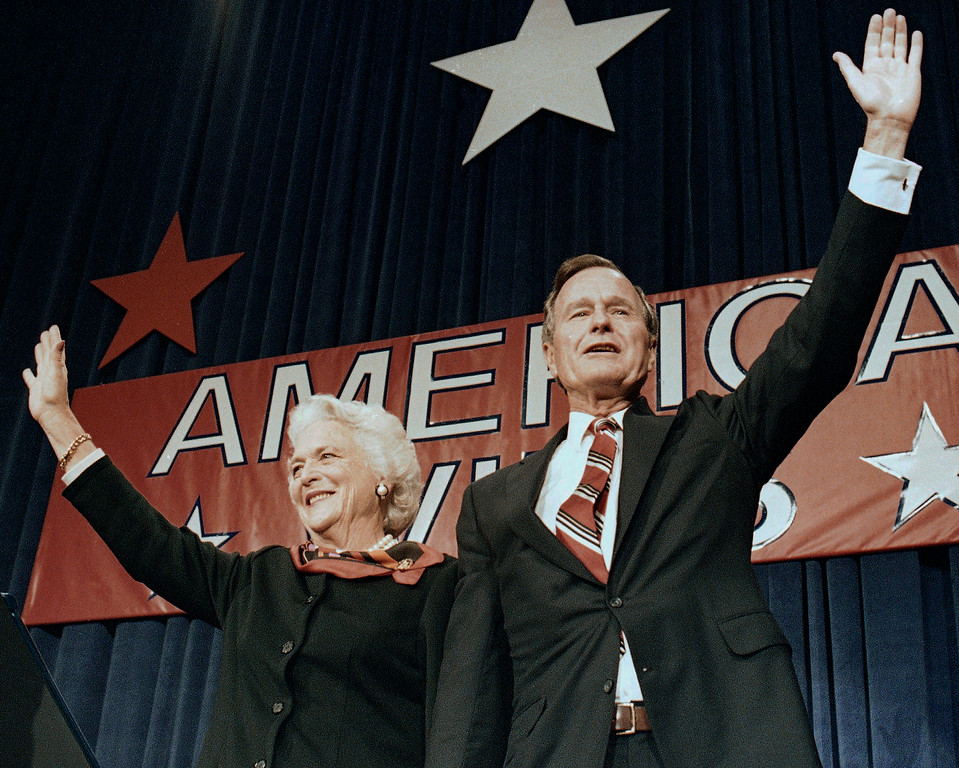 . FILE - In this Nov. 8, 1988 file photo, President-elect George H.W. Bush and his wife Barbara wave to supporters in Houston, Texas after winning the presidential election. Bush has died at age 94. Family spokesman Jim McGrath says Bush died shortly after 10 p.m. Friday, Nov. 30, 2018, about eight months after the death of his wife, Barbara Bush. (AP Photo/Scott Applewhite, File)