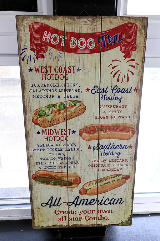 . George\'s Hot Dog Stand in Fitchburg is one of the local seasonal eateries in the North Central MA region. This sign at Geoge\'s is just some art that owner Joann Sisoian found but everyone thinks it is part of the menu and tries to order off of it. SENTINEL & ENTERPRISE/JOHN LOVE
