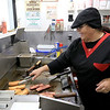 George's Hot Dog Stand in Fitchburg is one of the local seasonal eateries in the North Central MA region. Owner of George's Joann Sisoian grills up a customer order. SENTINEL & ENTERPRISE/JOHN LOVE