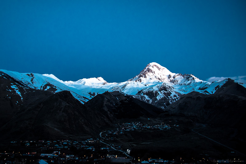 Mt Kazbegi in moonlit sky