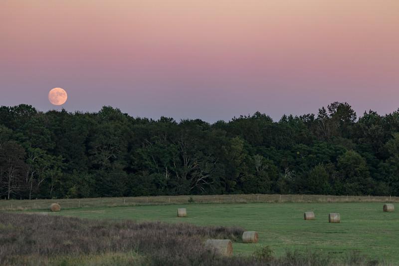 Full Moon Rising Over Hay Bales