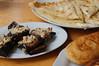 Fantastic Georgian cuisine: badrijani (eggplant stuffed with crushed walnut), khachapuri imeruli (cheese-stuffed bread) and mchadi (cornbread)