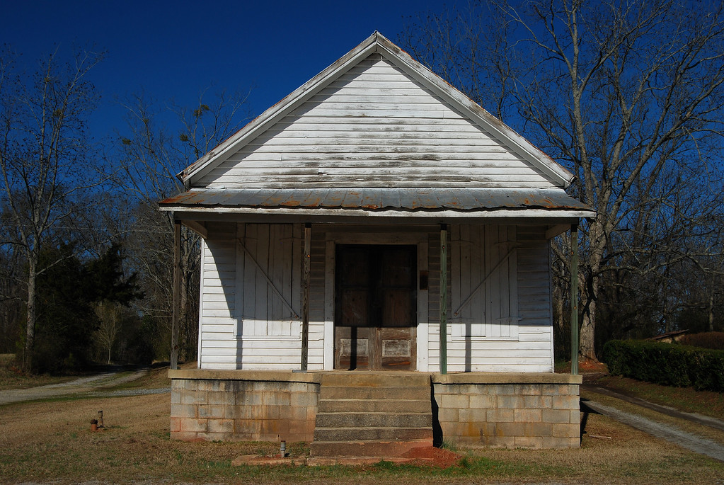 Abandoned store/post office, Taliaferro County (GA) 2008<br /> <br /> This old general store and gas station sits right by the railroad tracks and also used to serve as a post office. The mail was delivered by train, however, the train did not stop here; instead, it just slowed down enough for someone to hang the bag of mail on a post near this store.
