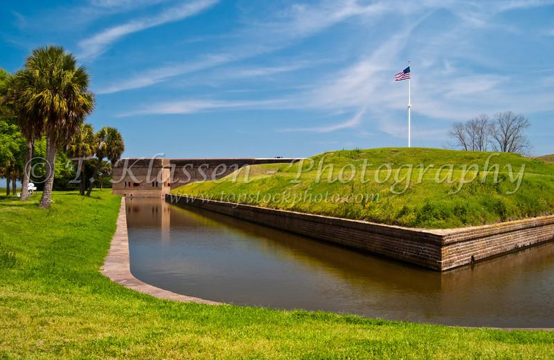 The historic Fort Pulaski with american flag and moat, on Cockspur Island, Georgia, USA, America.
