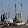 Fishing boats moored on the shores of the Savannah River. Tybee Island, GA<br /> <br /> GA-080627-0045-1