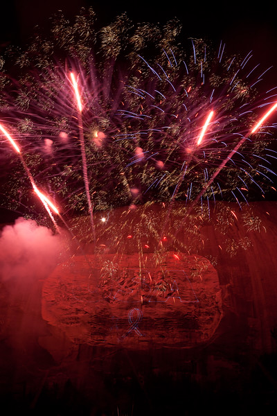 Stone Mountain glows red from the light of the fireworks show. Stone Mountain, GA<br /> <br /> GA-100626-0012