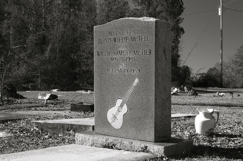 """The grave of blues singer Blind Willie McTell, McDuffie County (GA) 2008<br /> <br /> William Samuel McTier, better known as Blind Willie McTell (May 5, 1901 – August 19,  1959), was an influential American blues singer, songwriter, and guitarist. He played 6-string and 12-string guitar and recorded from 1927 to 1955. He wrote the song """"Statesboro Blues"""" which was made popular by the Allman Brothers in 1969.<br /> <br /> Born in Thomson, Georgia, blind in one eye, McTell had lost his remaining vision by late childhood.  His father left the family when McTell was still young, and when his mother died in the 1920s, he left his hometown to pursue a music career. He started out recording for Victor Records in Atlanta but later recorded for a number of labels under different names. His style was a sort of country blues, combining the raw blues of the Mississippi Delta with the more refined East Coast sound.  <br /> <br /> In 1934, he married Ruth Kate Williams but most of their marriage from 1942 until his death was spent apart, with her living in Fort Gordon near Augusta, and him working around Atlanta.<br /> <br /> Post-WWII, he recorded for Atlantic Records and for Regal Records, but these recordings were less successful commercially. He continued to perform live in Atlanta, but his career was cut short by bad health, predominantly diabetes. McTell died in Milledgeville, Georgia of a stroke in 1959 and lies buried near Thomson in the small roadside cemetery of an equally small baptist church. <br /> <br /> A blues festival in McTell's honor is held annually in his birthplace, Thomson, Georgia."""
