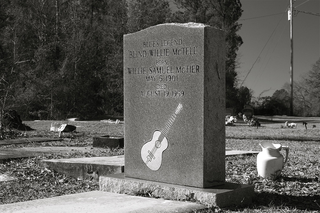 "The grave of blues singer Blind Willie McTell, McDuffie County (GA) 2008<br /> <br /> William Samuel McTier, better known as Blind Willie McTell (May 5, 1901 – August 19,  1959), was an influential American blues singer, songwriter, and guitarist. He played 6-string and 12-string guitar and recorded from 1927 to 1955. He wrote the song ""Statesboro Blues"" which was made popular by the Allman Brothers in 1969.<br /> <br /> Born in Thomson, Georgia, blind in one eye, McTell had lost his remaining vision by late childhood.  His father left the family when McTell was still young, and when his mother died in the 1920s, he left his hometown to pursue a music career. He started out recording for Victor Records in Atlanta but later recorded for a number of labels under different names. His style was a sort of country blues, combining the raw blues of the Mississippi Delta with the more refined East Coast sound.  <br /> <br /> In 1934, he married Ruth Kate Williams but most of their marriage from 1942 until his death was spent apart, with her living in Fort Gordon near Augusta, and him working around Atlanta.<br /> <br /> Post-WWII, he recorded for Atlantic Records and for Regal Records, but these recordings were less successful commercially. He continued to perform live in Atlanta, but his career was cut short by bad health, predominantly diabetes. McTell died in Milledgeville, Georgia of a stroke in 1959 and lies buried near Thomson in the small roadside cemetery of an equally small baptist church. <br /> <br /> A blues festival in McTell's honor is held annually in his birthplace, Thomson, Georgia."