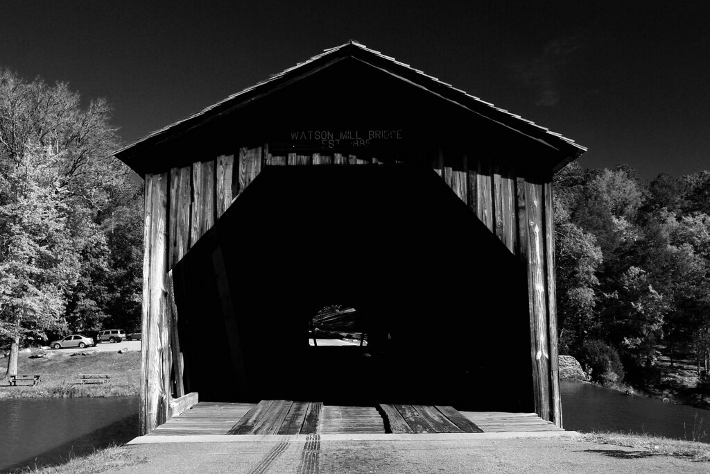 Watson Mill Bridge State Park, Madison County (GA) October 2008<br /> <br /> Watson Mill Bridge is one of about 20 covered bridges that remain in Georgia today. It is  229 feet (69 m) long and runs across the South Fork of the Broad River. The 100-year old bridge is supported by a town lattice truss system held