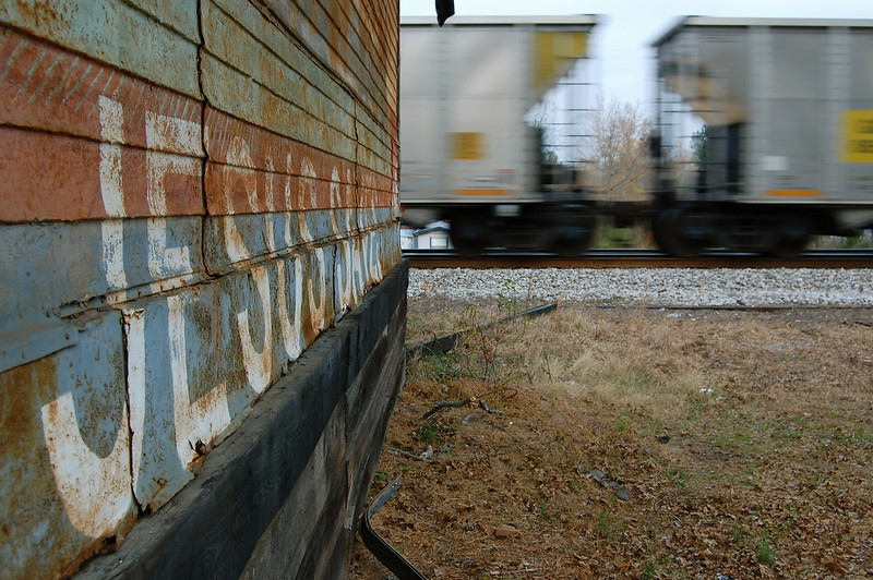 Mural at the old depot and passing train in Crawfordville, GA (Taliaferro County). Copyright 2007