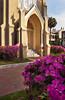 A church door with azalea blossoms in Savannah, Georgie, USA.