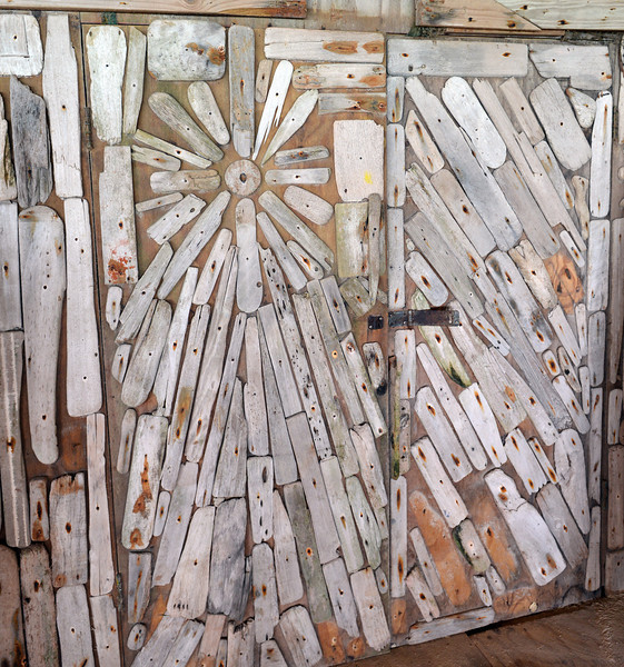Driftwood covered doors in surfer hang-out, Bonaire