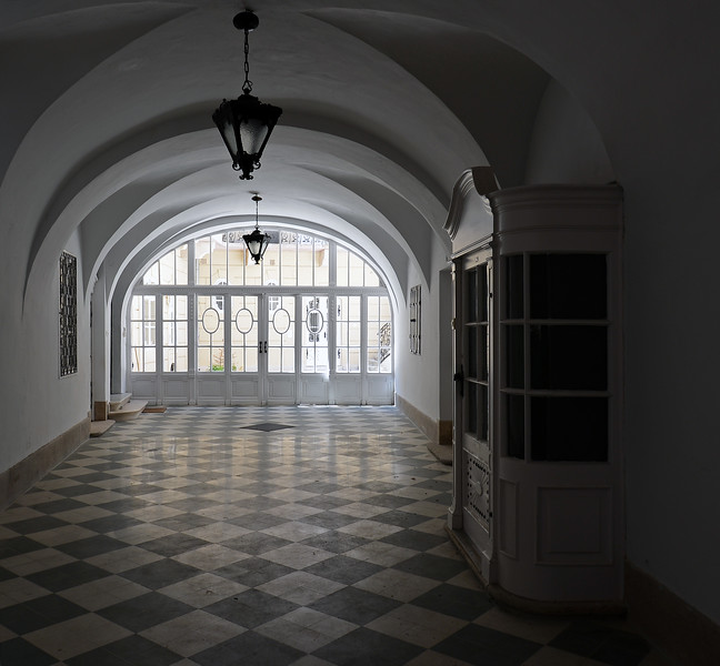 Arched hallway in restored 19th century building in Budapest, Hungary