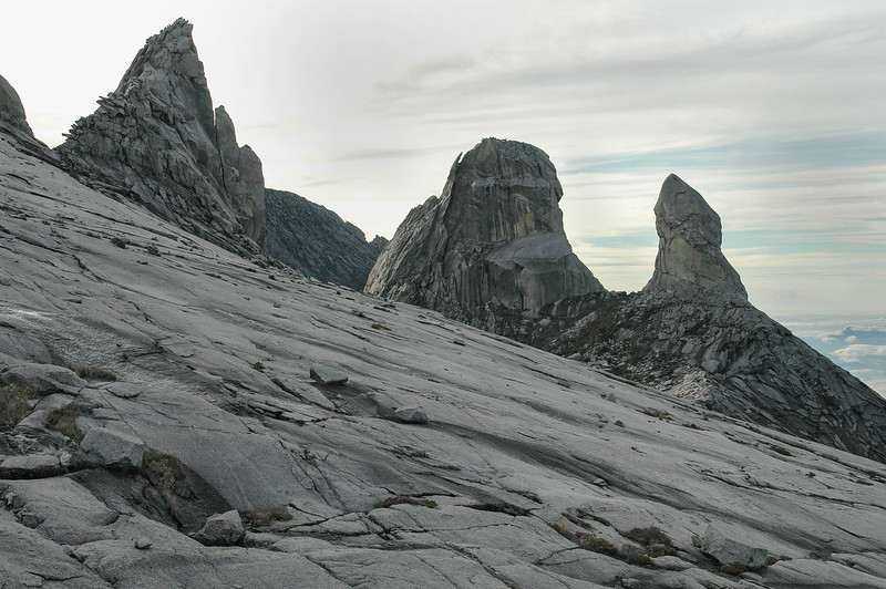 "Giant granite rock faces and steep pinnacles (with the two ""Donkey's Ears"" at right) near the summit (4095 m) of Gunung Kinabalu in Sabah, Malaysia"
