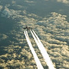 Vapour trails behind an eastbound British Airways B747 above central France