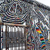 Colorful paintings surrounding gate in remnant of the Berlin Wall, Germany