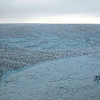 Rapid calving of icebergs from the giant Sermeq Kujalleq glacier into the Kangia fjord, west Greenland
