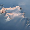 Mountain ridge covered by thick ice and snow, east Greenland