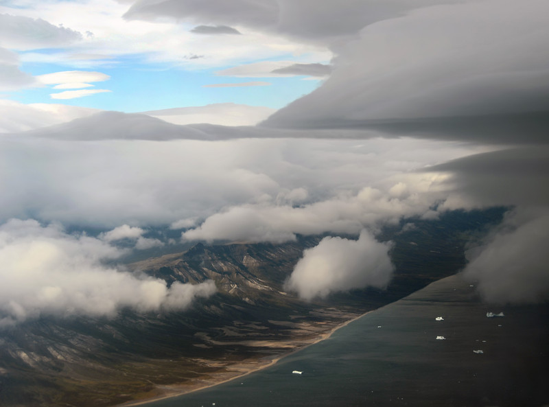 Weatherfront moving over northeast coast of Disko Island and Vaigat channel, west Greenland