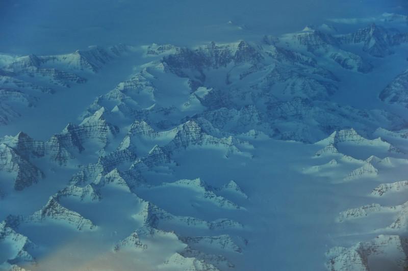 Last light rays on steep ridges of layered Tertiary basaltic lavas in the Sortebræ ranges, east-central Greenland