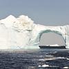 High arch in giant iceberg near Disko island, Greenland