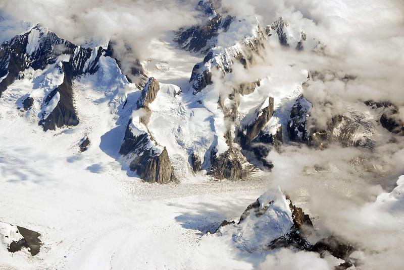 Ruth Glacier cutting through steep mountain ridges south of Mount McKinley, Alaska