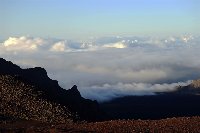 Clouds onlapping the edge of the Haleakala crater on Maui, Hawaii