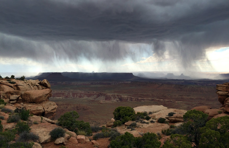 Heavy downpour from large thunderstorm over Canyonlands National Park in Utah, USA