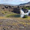 Hjalparfoss waterfall over columnar lava flow, Iceland