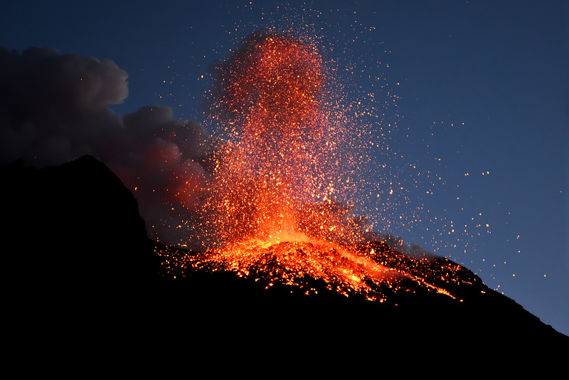 Pyroclastics (molten rocks) thrown from the main vent of the Stromboli volcano, Italy (height of column ca. 150 m)