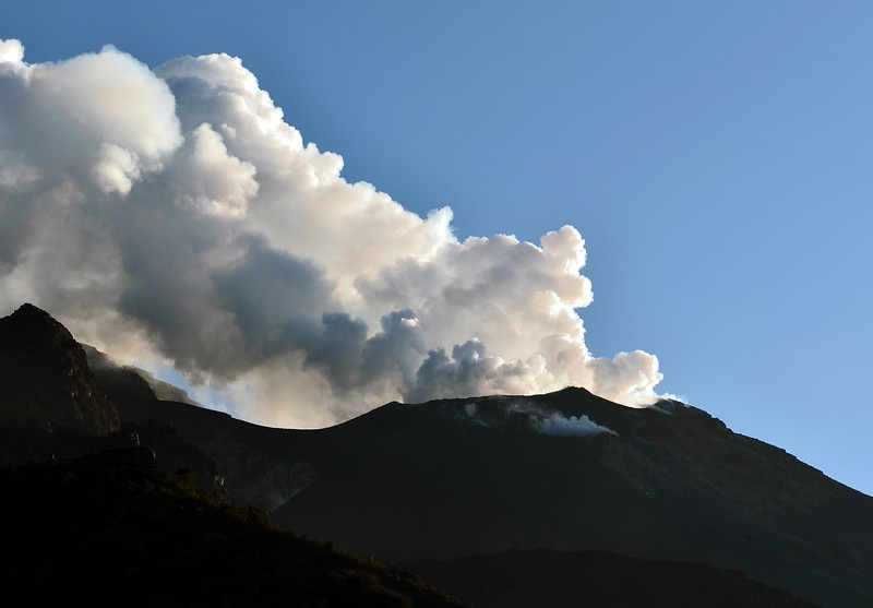 Large column of steam and very fine ash emanating from the Stromboli crater, Italy