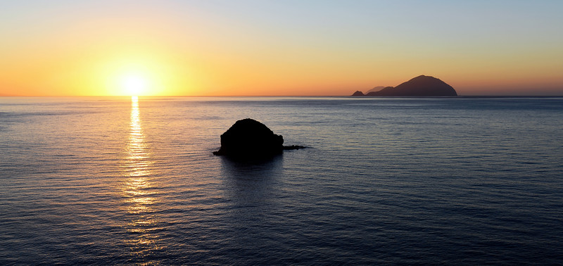Sunset view from Salina's western coast towards the islands of Filicudi and Alicudi