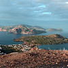 View from steaming crater edge over the village of Vulcano Porto, with Lipari and other Eolian islands in the background