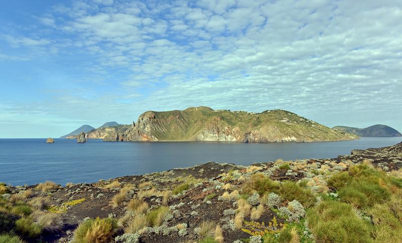 View across narrow sea strait separating the Vulcano and Lipari islands, Italy