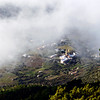 Afternoon fog lifting around the Madonna del Terzito church in the hamlet of Valdichiesa on the island of Salina, Italy