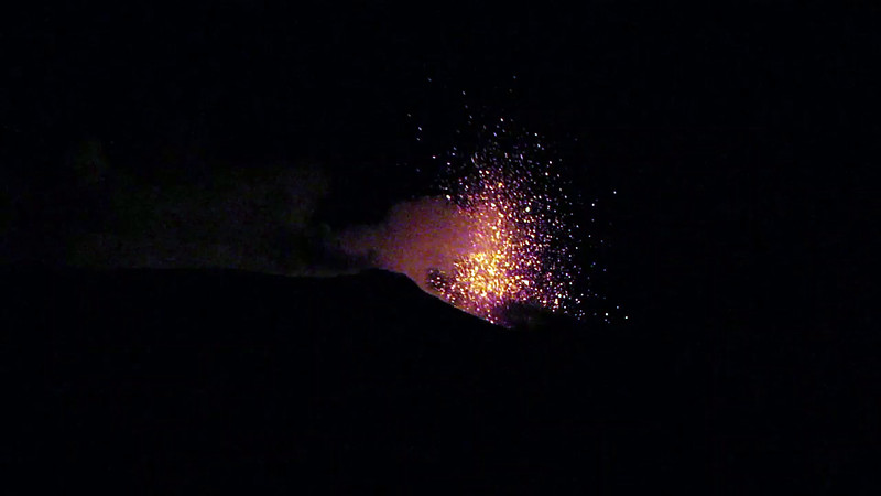 Minor night time effusive activity with incandescent lava fragments spewing out from a vent near Stromboli's main crater, Italy