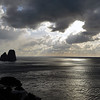 Stormy skies over sea stacks (faraglioni) at Capri, Italy