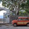 Fiat 500 Giardiniera parked at entrance to luxurious villa in Capri, Italy