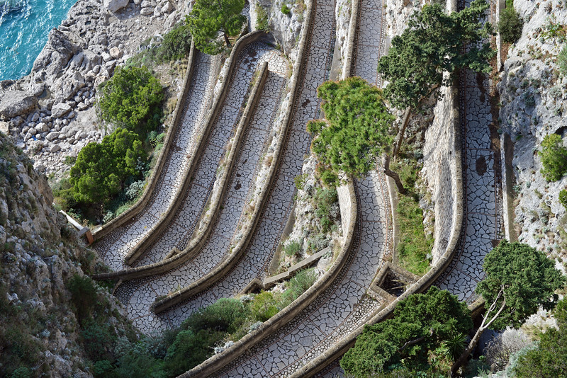 Historic paved footpath with switchbacks (Via Krupp) along the southern cliffs of Capri, Italy