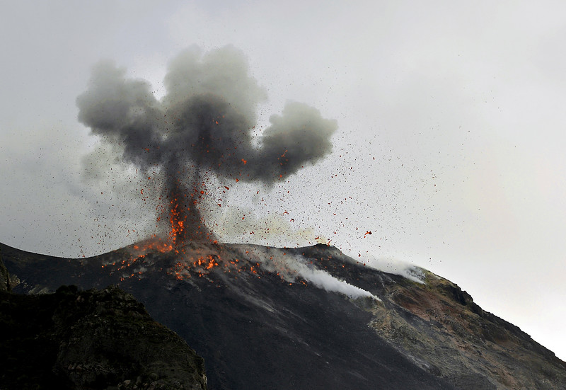 Explosive activity with gas, ash and lava bombs coming out of Stromboli's summit crater, Italy